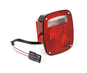 Omix-ADA - Left Hand Tail Light with Black Housing; 1987-1990 Wrangler YJ